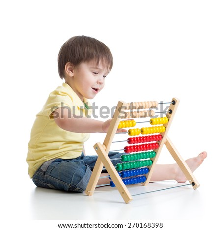 Smiling child boy playing with counter toy isolated - stock photo