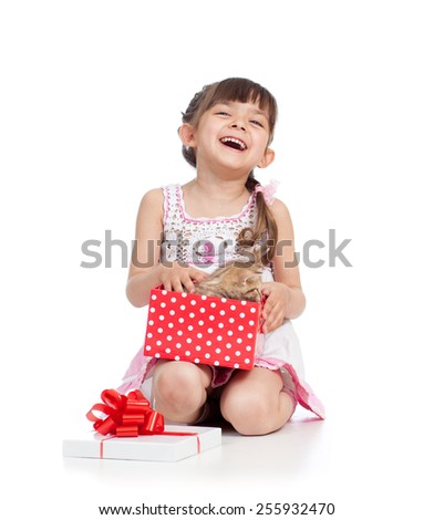 smiling child girl holding gift box with little cat