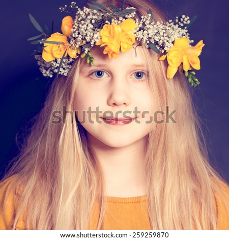 Smiling child girl with yellow flowers - stock photo