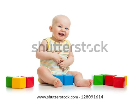 smiling child playing with colorful building blocks or bricks - stock photo