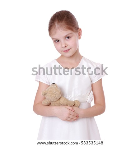 Smiling child playing with teddy bear