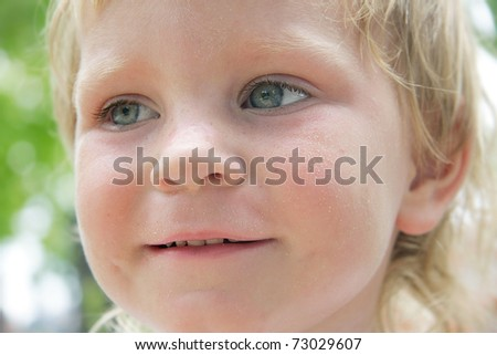 smiling child portrait on natural background