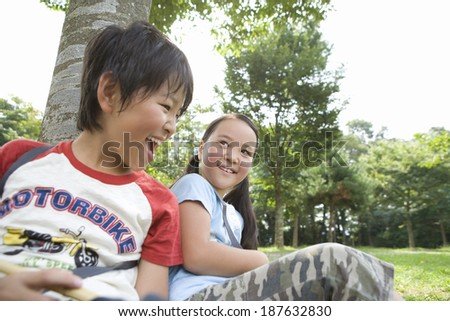 smiling child sits on lawn