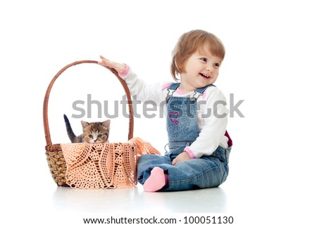 Smiling child sitting down by basket with kittens, isolated on white - stock photo