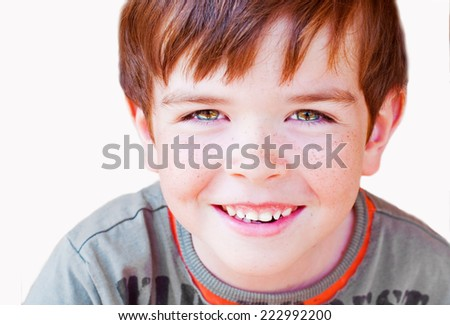 Smiling child with freckles, isolated on white - stock photo