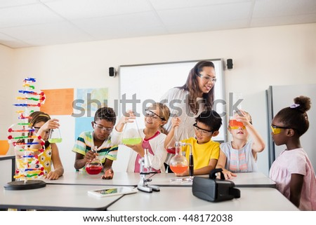 Smiling children doing science in classroom
