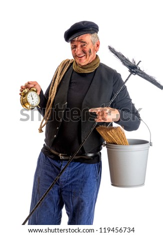 Smiling chimney sweep showing midnight New Year on his alarm clock - stock photo