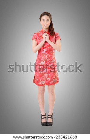 Smiling Chinese woman dress traditional cheongsam at New Year, studio shot isolated. - stock photo