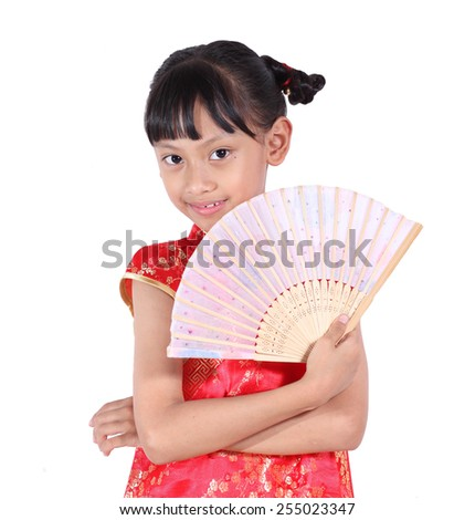 Smiling Chinese woman dress traditional cheongsam at New Year, studio shot isolated on white background.