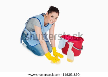 Smiling cleaning woman washing the floor on white background - stock photo