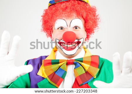 smiling clown with white gloves - stock photo