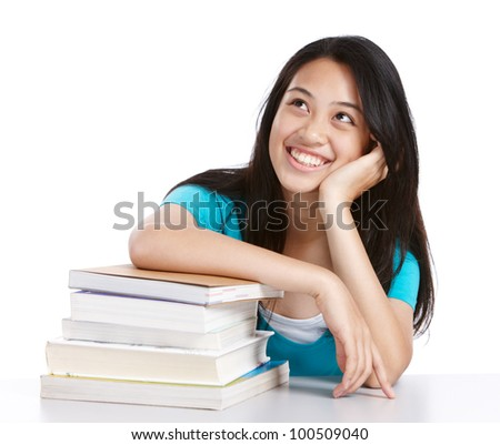 smiling college student wondering or thinking about something - stock photo