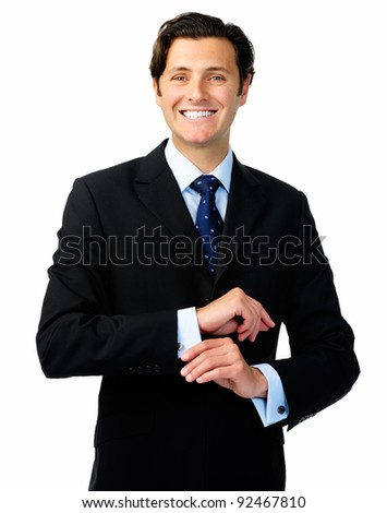 Smiling confident business man in a formal suit adjusts his cufflinks - stock photo