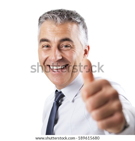 Smiling confident businessman tumbs up on white background. - stock photo