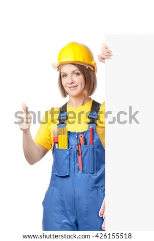 smiling construction female worker holding blank board with empty copy space for you text isolated on white background. advertisement banner. your text here. thumb up gesture - stock photo