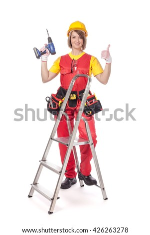 smiling construction female worker with ladder and drill showing thumb up isolated on white background. advertisement gesture
