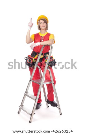 smiling construction female worker with ladder pointing up isolated on white background