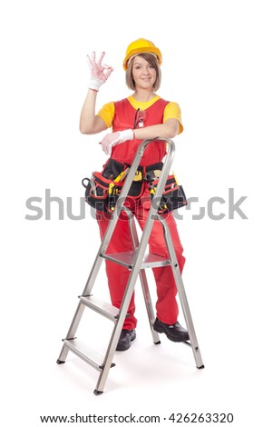 smiling construction female worker with ladder showing an okay sign isolated on white background. advertisement gesture
