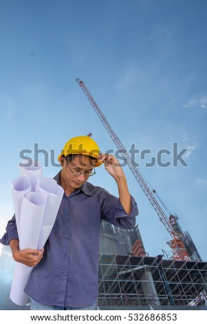 Smiling construction manager standing on building site