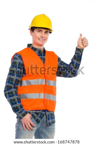 Smiling construction worker in yellow helmet and orange waistcoat showing thumb up. Three quarter length studio shot isolated on white. - stock photo