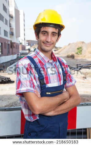 Smiling construction worker with black hair
