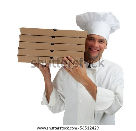 smiling cook in white uniform and hat with boxes of pizza