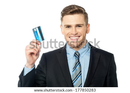 Smiling corporate executive showing his credit card