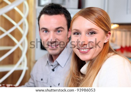 Smiling couple at home - stock photo
