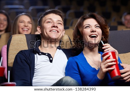 Smiling couple at the cinema