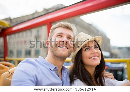 Smiling couple at the tour bus - stock photo