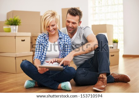 Smiling couple buying new furniture for their home   - stock photo