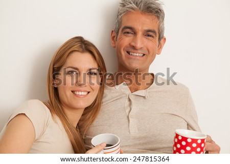 Smiling couple drinking a coffee - stock photo