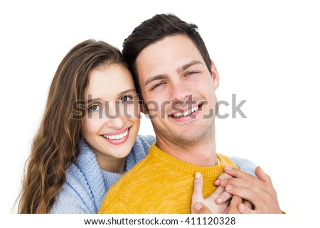 Smiling couple embracing and looking the camera on white background - stock photo