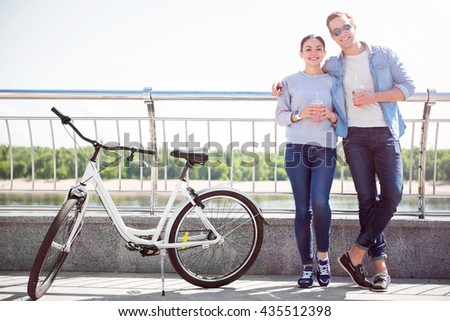 Smiling couple having a drink - stock photo