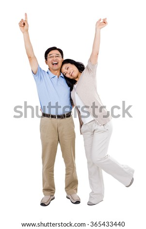 Smiling couple holding each other and celebrating