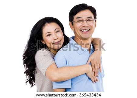 Smiling couple holding each other close