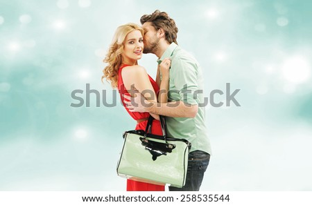 Smiling couple hugging each other - stock photo
