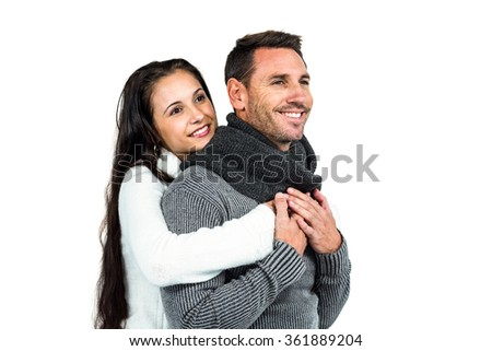Smiling couple hugging on white background