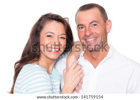 Smiling couple in front of white background - stock photo