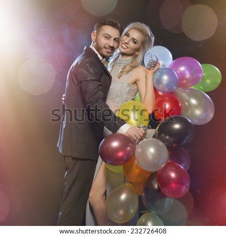 Smiling couple in love on the new years eve party - stock photo
