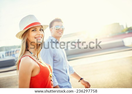 Smiling couple in love outdoors - stock photo