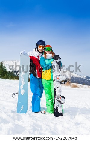 Smiling couple in ski masks standing together