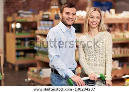Smiling couple in the store