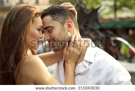 Smiling couple kissing each other - stock photo