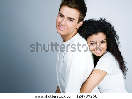 Smiling couple on a blue  background - stock photo