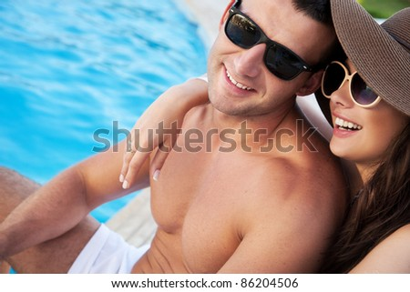 Smiling couple on vacation day - stock photo
