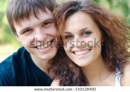 Smiling couple outdoors