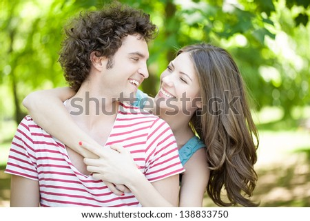 Smiling couple spending a summer day outdoors together.