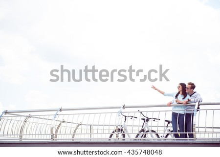 Smiling couple standing on the quay - stock photo