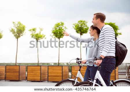 Smiling couple standing on the square - stock photo